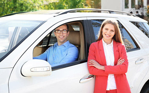 Young couple with new car