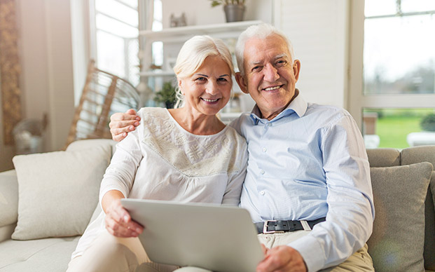 Retirement couple discussing investment options